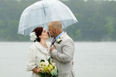 Couples rainy day wedding photography Lake Johnson NC