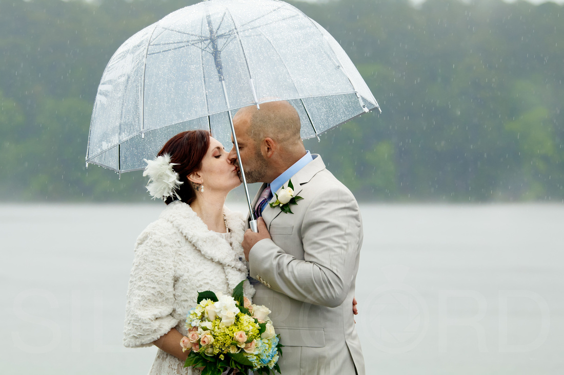 Couples rainy day wedding photography Lake Johnson NC